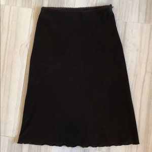 Brown skirt with scalloped hem
